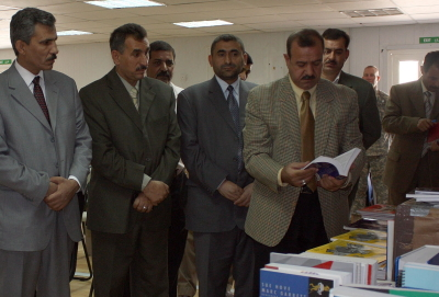 Dhi Qar University faculty examine ESL material donated by Book Wish Foundation