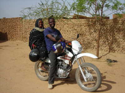 Taha and Khadija motorcycling to the villages, Hadjer Hadid, Chad