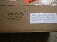 box containing donated glasses for Darfur refugees