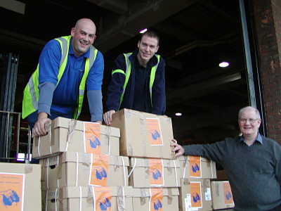Brian Godfrey and the Air France team prepare Headway English books for shipment from London to N'Djamena, Chad
