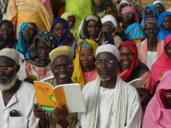 Darfur refugees with new reading glasses in Bredjing Refugee Camp