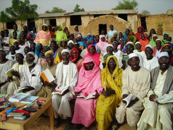 Darfur refugees in Bredjing Refugee Camp receive reading glasses