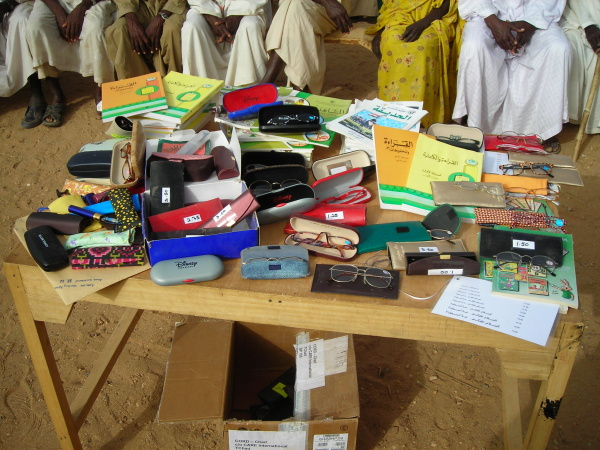 Reading glasses and near vision testing materials in Bredjing Refugee Camp