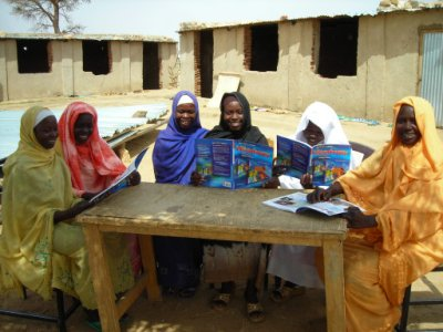 Young Darfuri women studying their new English books, donated by Book Wish Foundation
